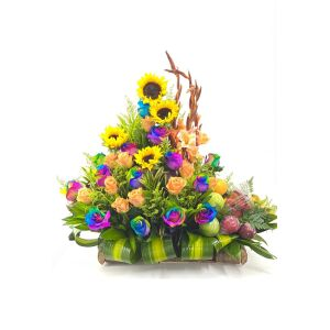 Rainbow arrangement with sunflowers and fruit